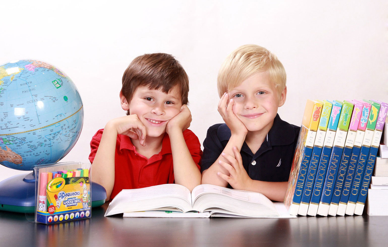 two-boys-reading-smiling